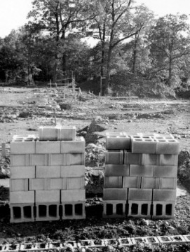 Image of cinder blocks and the early stages of building Orange Grove Center.